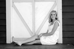Blond seated, black and white Royalty Free Stock Photos