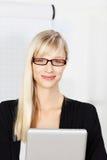 Blond secretary with glasses Stock Photos