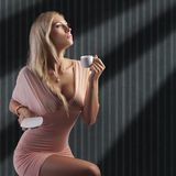 Blond sensual lady with a cup coffee stock photos