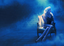 Blond sensual lady in a mysterious place Stock Photo