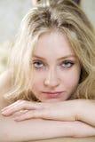 Blond serious teen girl Stock Photography