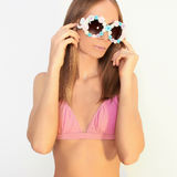 Blond girl in a bikini and sunglasses royalty free stock photo