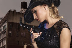 Blond sexy girl with handgun pistol gangster style Stock Photos