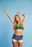 Blond sexy girl with short jeans on blue Stock Image
