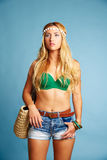 Blond sexy tourist girl short jeans and basket bag Royalty Free Stock Photo