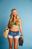 Blond sexy tourist girl short jeans and basket bag Royalty Free Stock Photos