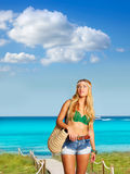 Blond sexy tourist girl in tropical beach Formentera Royalty Free Stock Photos