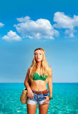 Blond sexy tourist girl in tropical beach Formentera Stock Image
