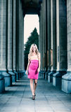 Blond sexy woman  between the columns. Stock Images