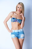 Blond sexy woman in short jeans and bikini bra Royalty Free Stock Photography