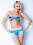Blond sexy woman in short jeans and bikini bra Royalty Free Stock Photo
