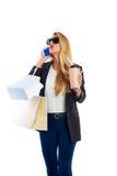 Blond shopaholic kobiet torby, smartphone i Fotografia Stock