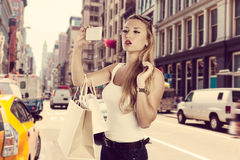 Blond shopaholic tourist girl selfie photo NYC Soho Stock Photo