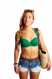 Blond short jeans sexy tourist woman going beach. With basket bag and sungrlasses on hair Royalty Free Stock Image