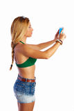 Blond short jeans sexy woman selfie tablet photo Stock Images