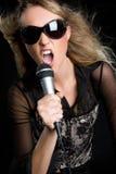 Blond Singer. Beautiful pretty blond karaoke singer Royalty Free Stock Photos