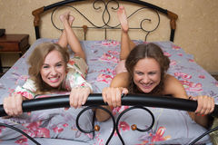 Blond sisters or sexy girl friends having fun Stock Photos