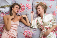 Blond sisters or sexy girl friends having fun Royalty Free Stock Image