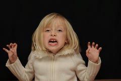 blond skrämd flicka arkivfoton