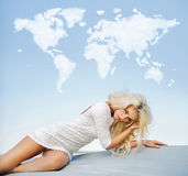 Blond slim lady with the cloud world above Stock Image