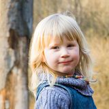 Blond smart looking child. A young blond smart looking girl Royalty Free Stock Photo