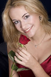 Blond smelling rose. Beautiful blond woman holding red rose and smelling them Stock Images
