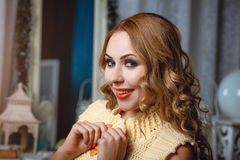 Blond smiled girl in beige waiscoat. Royalty Free Stock Images