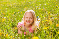 Blond smiling cute girl in yellow flowers Stock Photo