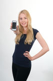 Blond smiling girl showing mobile phone Royalty Free Stock Photo