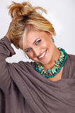 Blond smiling tanned woman Royalty Free Stock Photos