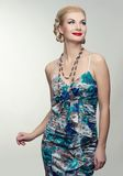 Blond smiling woman in colorful dress Royalty Free Stock Image