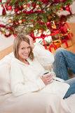 Blond smiling woman in front of Christmas tree Stock Photos