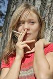 Blond smoking girl Royalty Free Stock Image