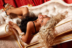 Blond on a sofa Stock Image