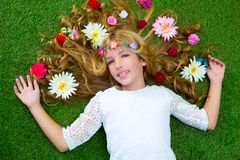 Blond spring girl with flowers on hair over grass Royalty Free Stock Photos