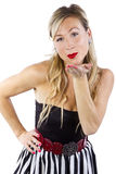 Blond in Striped Dress Blowing a Kiss Royalty Free Stock Photos