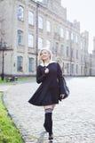 Blond student girl in schoolyard Stock Photo