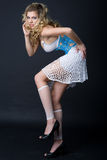 Blond in studio. Nice blond in colorful dress Royalty Free Stock Photo