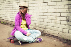 Blond stylish teenage girl in jeans and sunglasses Stock Photography