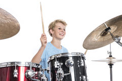 Free Blond Teen Boy Plays Drums At Drumkit In Studio Against White Ba Royalty Free Stock Photography - 96552017