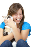 Blond teen with cat Royalty Free Stock Image