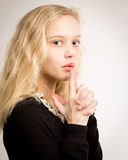 Blond Teen Girl Blowing Smoke From Finger Gun Stock Image