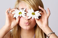 Blond teen girl with daisies Royalty Free Stock Image