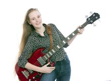 Blond teen girl with electric bass guitar against white background stock photography