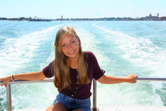Blond Teen girl at sea ship dock Stock Images
