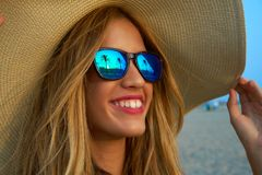 Blond teen girl sunglasses and pamela sun hat. At palm tree sunset Stock Photo