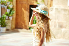 Blond teen girl tourist in Mediterranean old town Royalty Free Stock Photos
