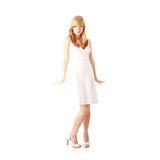Blond teen girl in white dress Stock Images