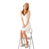 Blond teen girl in white dress. Young beautiful blond teen girl in white dress full portrait isolated Royalty Free Stock Image