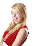 Blond teen girl winking Royalty Free Stock Photo